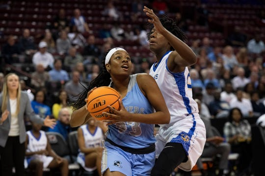 Christ Church Espicopal's Yasmene Clark (23) moves around North Charleston's Tranell Mitchell-Smalls (23) to score a basket during the Class AA state championship held at Colonial Life Arena in Columbia Friday, Mar. 6, 2020.