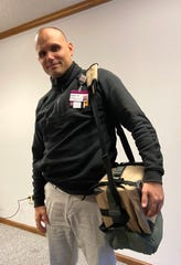 Aaron Dix, executive director of Prisma Health's emergency medical services, wears a new blood transfusion kit now used by emergency responders to save lives.