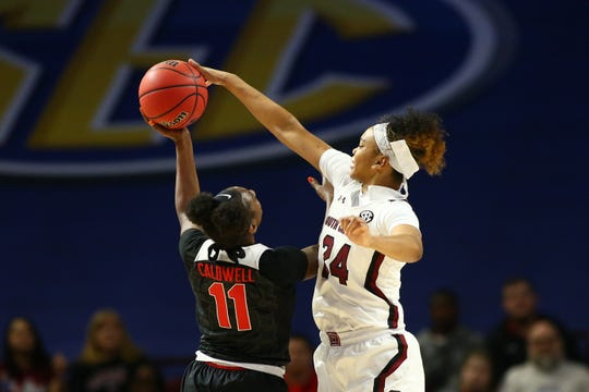 Mar 6, 2020; Greenville, SC, USA; South Carolina Gamecocks guard LeLe Grissett (24) blocks the shot of Georgia Lady Bulldogs guard Maya Caldwell (11) during the first half at Bon Secours Wellness Arena. Mandatory Credit: Jeremy Brevard-USA TODAY Sports