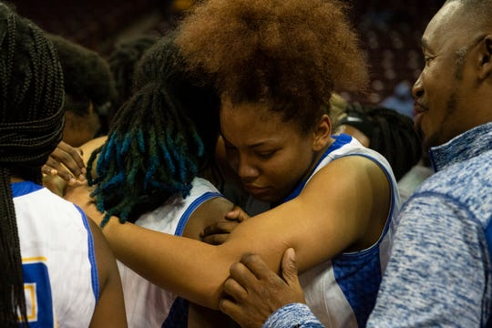 North Charleston's Sophia Simmons (15) (right) hugs teammate Ca'Vashia Johnson (3) after winning the Class AA state championship held at Colonial Life Arena in Columbia Friday, Mar. 6, 2020.