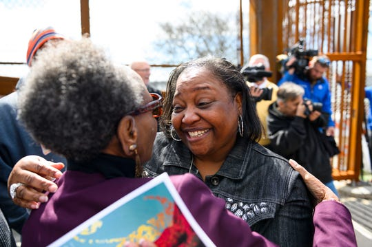 Rene Vaughn and Mary Duckett of the Southernside Neighborhood Association embrace one another during the dedication ceremony of the Hampton Avenue Bridge Friday, March 6, 2020.