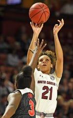 South Carolina's Mikiah Herbert Harrigan (21) lifts a jumper as Georgia's Stephanie Paul (3) defends. South Carolina plays Georgia as the SEC Women's Basketball Tournament continues at Bon Secours Wellness Arena in Greenville Friday, March 6, 2020.GWINN DAVIS / MEDIA