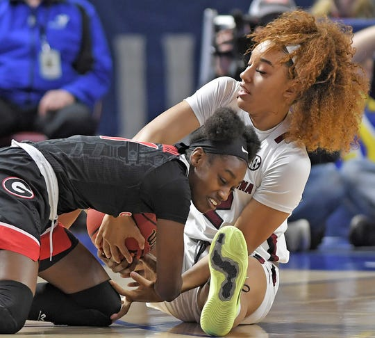South Carolina's Brea Beal (12) and Georgia's Maya Caldwell (11) battle for the ball. South Carolina plays Georgia as the SEC Women's Basketball Tournament continues at Bon Secours Wellness Arena in Greenville Friday, March 6, 2020.