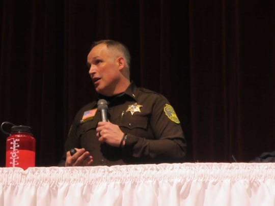 Cascade County Sheriff Jesse Slaughter guides the audience through his office's challenges with jail overcrowding and lack of detention staff at Thursday's Public Safety Town Hall at the Mansfield Theater.
