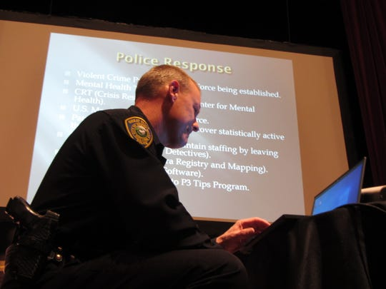 Great Falls Police Department Chief Dave Bowen opens a slideshow showing police response information at Thursday's Public Safety Town Hall.