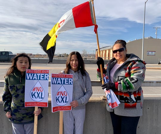 Debbie McShane, president of the American Indian Movement for the state of Montana, brought her two children, Sky Running Enemy, 10 (left) and Kendalyn Running Enemy, 11 (middle), to protest the Keystone XL Pipeline in Great Falls.