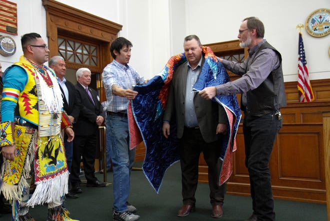 Veterans present Sen. Jon Tester with a quilt. Veterans, mentors and community members gathered in the Great Falls Veterans Treatment Courtroom to honor the service of Native American veterans on Friday, Mar. 6, 2020.