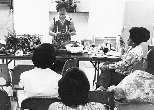 Guam local food expert Lorraine M. Aguon answers questions about traditional cooking at a 1978 session.