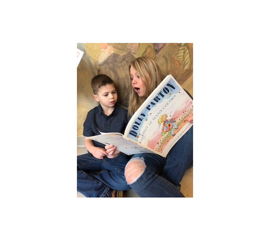 Chloe Liley reading to her younger brother Elijah.