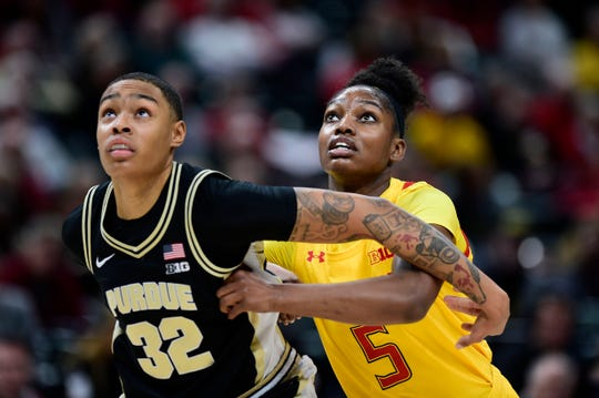 Mar 6, 2020; Indianapolis, Indiana, USA; Purdue Boilermakers forward Ae'Rianna Harris  (32) and Maryland Terrapins guard Kaila Charles (5) battles for position at Bankers Life Fieldhouse. Mandatory Credit: Thomas J. Russo-USA TODAY Sports