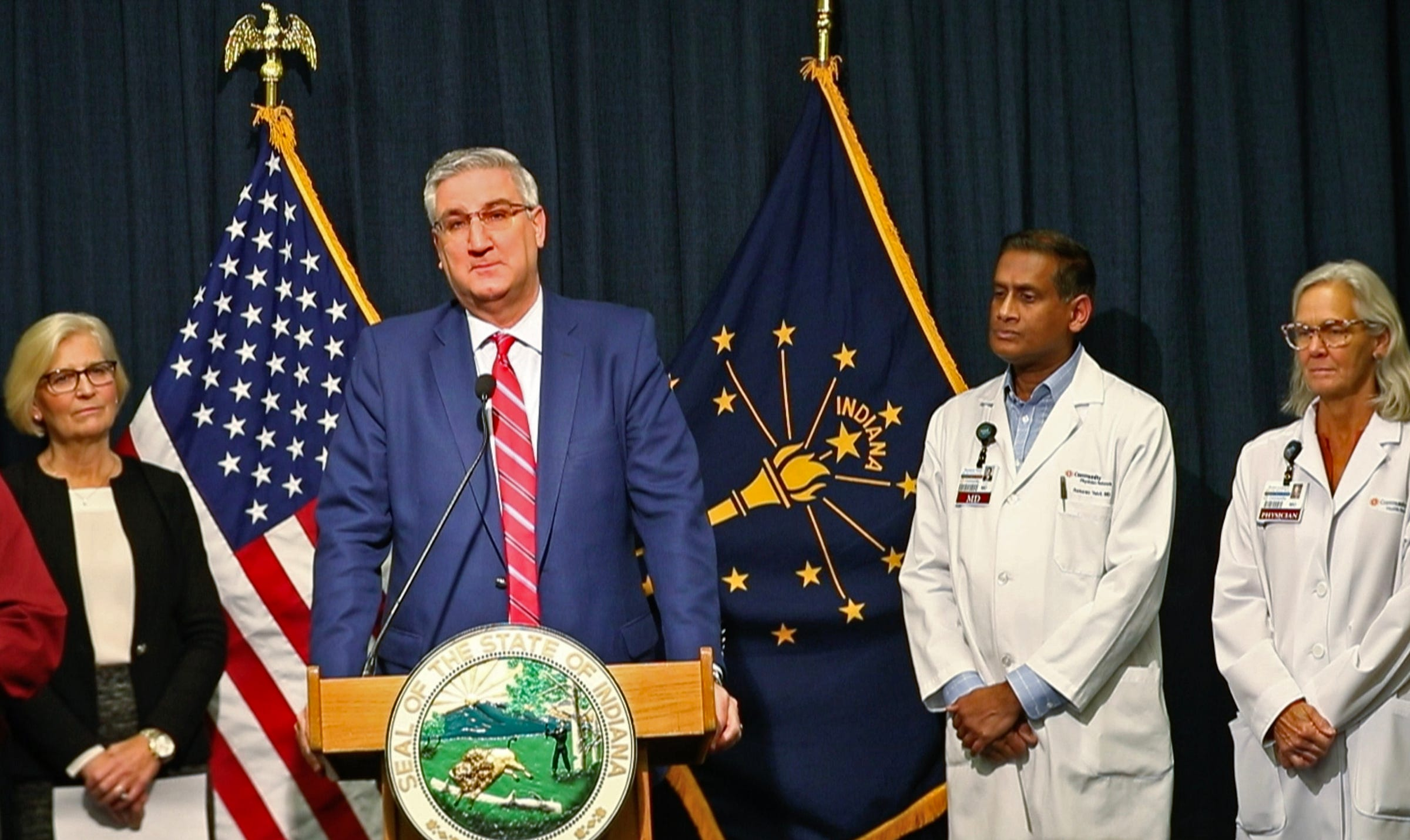 Gov. Eric Holcomb announces during a press conference at the Indiana Statehouse that the first case of COVID-19 has been diagnosed in Indiana.