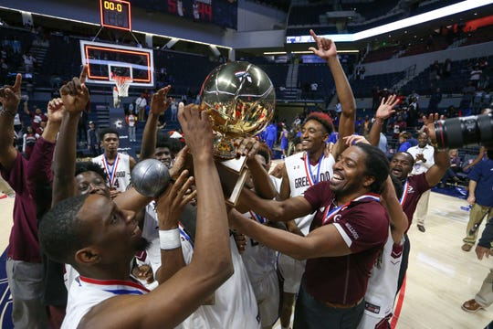 Greenwood head basketball coach Fredric Ford and his team celebrate with the MHSAA Class 4A Basketball Championship trophy during the 2020 MHSAA Basketball Class 4A Championship at the Pavilion at Ole Miss on Thursday, March 5, 2020.