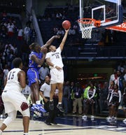 Raymond High School's Kearius Stimage (32) tries to block the shot of Greenwood High School's Deandre Smith  (10) during the 2020 MHSAA Basketball Class 4A Championship at the Pavilion at Ole Miss on Thursday, March 5, 2020.