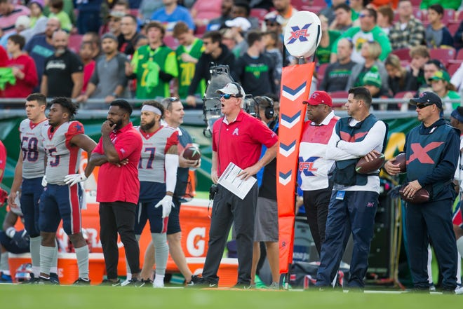 UL product and Houston Roughnecks wide receiver Ryheem Malone (second from left) is shown on the sideline as Roughnecks head coach June Jones (right) reacts during a game against the Tampa Bay Vipers.