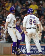 LSU's Daniel Cabrera (8) celebrates with Cade Beloso (24) after hitting a two-run home run against Texas during the sixth inning of a Shriners Hospitals for Children College Classic baseball game Friday, Feb. 28, 2020, in Houston. (Steve Gonzales/Houston Chronicle via AP)