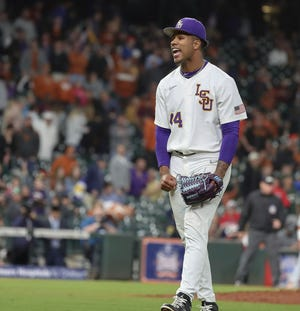 LSU relief pitcher Jaden Hill (44) reacts to the final strikeout of the Shriners Hospitals for Children College Classic baseball game against Texas, Friday, Feb. 28, 2020, in Houston. (Steve Gonzales/Houston Chronicle via AP)