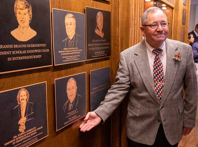 Ted Ralph receives a plaque on the University of Louisiana at Lafayette Foundation Hall of Honor for his $600,000 gift to establish the T.H. Ralph/BoRSF Endowed Chair in Mathematics on Thursday, March 5, 2020.