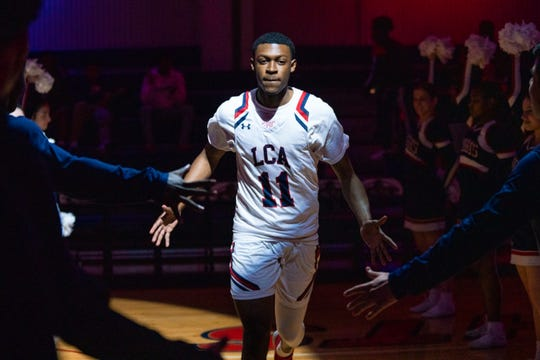Lafayette Christian's Victor Dupre walks onto the court before the game as the Lafayette Christian Academy Knights take on the St. Charles Catholic Comets on Thursday, March 5, 2020.