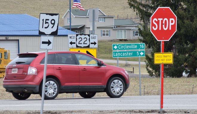 A car travels past the intersection of US 22 and Ohio 159. ODOT plans on putting two roundabouts at that intersection and the intersection at US 22 and Delmont Road, starting in 2021.