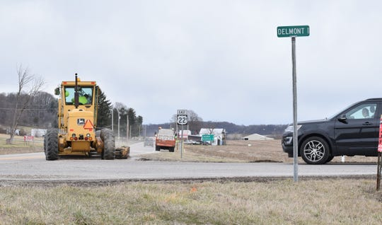 ODOT crews work on the shoulder of US 22 near the intersections of Delmont Road and Ohio 159. ODOT plans on putting two roundabouts at those intersections, starting in 2021.