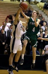 Fisher Catholic's Alex Bronder goes up for a layup against Grandview Heights' Luke Lachey during Thursday's Division IV district final at Ohio Dominican. The Irish fell 51-30 to the top-seeded Bobcats.