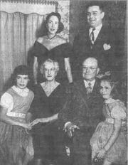 This photo was taken when Mr. & Mrs. Thomas Fulton celebrated their 45th anniversary at Timbertop. Standing are Mr. & Mrs. Cyrus Fulton. Seated are Mr. & Mrs. Thomas C. Fulton, with their two granddaughters, Miss Diana and Miss Holly Fulton. The photo appeared in the Eagle-Gazette 12 Nov. 1951.