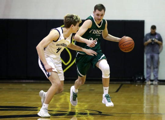 Grandview Heights' Adam Bechtel defends Fisher Catholic's Bryson Vogel during Thursday's Division IV district final at Ohio Dominican. The Irish fell 51-30 to the top-seeded Bobcats.