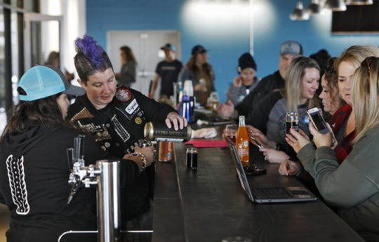 (LtoR)Sara Wright and Erin Campbell of Outerbelt Brewing pour samples to those in attendance of Women's Brew Day at Outerbelt Brewing in Carroll March 5, 2020. Outerbelt Brewing was holding a Women's Brew Day to help diversity in the industry and network for those individuals already working in the craft beer industry. [Eric Albrecht/Dispatch]