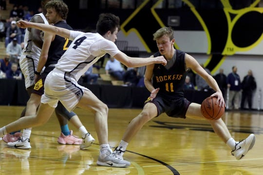 Berne Union's Levi Ross tries to maneuver past Wellington's Connor Herrick during Thursday's Division IV district final at Ohio Dominican. The Rockets fell 69-45 to the second-seeded Jaguars.