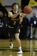 Berne Union's Chase McCartney passes the ball during Thursday's Division IV district final against Wellington at Ohio Dominican. The Rockets fell 69-45 to the second-seeded Jaguars.