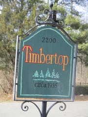This sign for Timbertop marks the entrance to the former Fulton estate on N. Columbus St.
