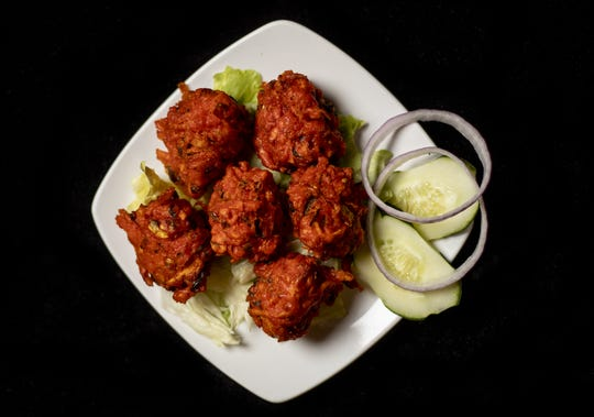 The Vegetable Pakora at Clay Oven Indian Restaurant are spiced vegetable fritters fried in vegetable oil. March 5, 2020