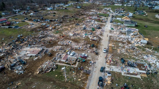 Residents of a subdivision west of Cookeville, Tennessee, begin the job of cleaning up, Mar 4, 2020, as rescue crews continue to search for more than 20 people who are still missing.  18 were confirmed killed in the tornado outbreak in Cookeville and Putnam County.