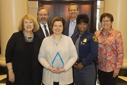 (From L-R) Michigan Court of Appeals Judge Amy Ronayne Krause, chair of the Michigan Domestic and Sexual Violence Prevention and Treatment Board; Matt Wiese, board member; Rebecca Campbell; Michigan Court of Appeals Judge Thomas Cameron, board member; Michigan State Police First Lt. Yvonne D. Brantley, board member; and Sue Snyder, board member.