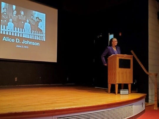 """Author Dedria Humphries speaking on her book """"Mother of Orphans"""" at the downtown Lansing library on Wednesday, March 4."""
