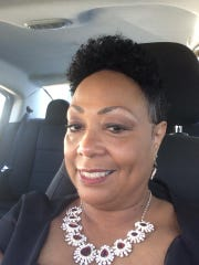 Kay Porter wears a natural hair style in 2018.
