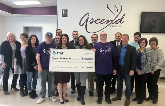 AT&T presents a $10,000 grant from the AT&T Foundation to Ascend Services in Manitowoc on Fridayto support prevocational and job readiness skills for people with disabilities.
