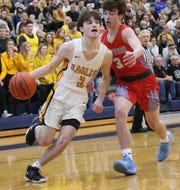 Colonel Crawford's Jordan Fenner dropped 19 points in the Eagles' district championship win over Eastwood on Thursday night.