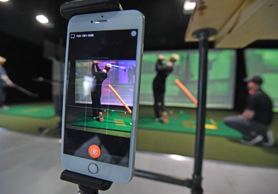 A smartphone captures Gavin Auck's swing for analysis at 419 Golf.