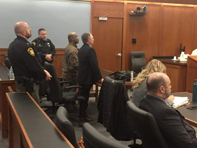Daniel Moore (c) was found guilty Friday on four counts of rape.