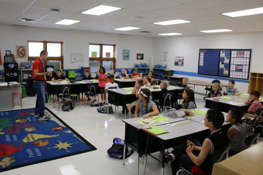 Marion City Schools officials continue to discuss ways to deal with enrollment issues and a lack of space in some buildings. Superintendent Ron Iarussi said elementary school buildings are at capacity. In this photo, Brandon Archibald is shown teaching a fourth-grade class at Garfield Elementary School.