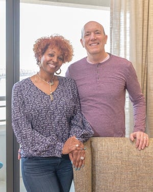 Leslie and John Daniel, who moved in the Artesian Building last summer, love their new home and its location overlooking the Mississippi river.