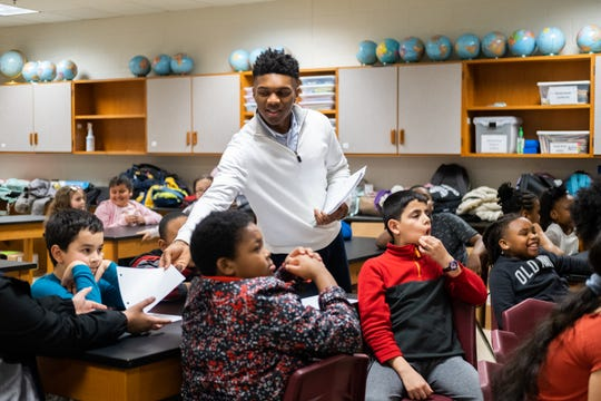 Collin Siddell, a senior at Houston High School and founder of the nonprofit A Diamond in the Rough, passes out paper to students at Dexter Elementary, Thursday, March 6, 2020, in Memphis, Tenn.