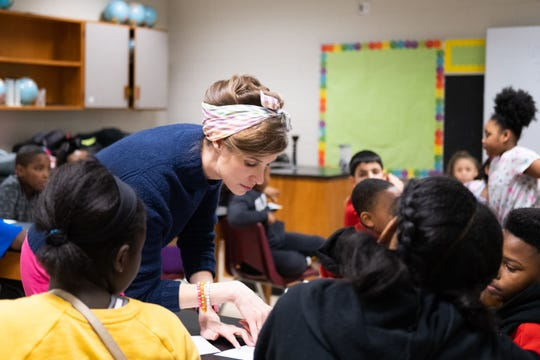 Kat Gordon looks at a student's handwritten notes during A Diamond in the Rough meeting at Dexter Elementary, Thursday, March 6, 2020, in Memphis, Tenn.