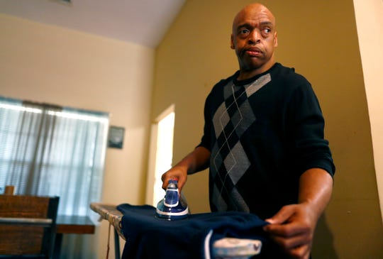 Victor Griffin irons his clothes at an assisted living home on Thursday, Feb. 20, 2020. SRVS, a disability support service works with developmentally and physically disabled people such as Griffin to help meet their needs, through housing home care and social activities also training along the way in ways in which they can empower themselves in their own lives.