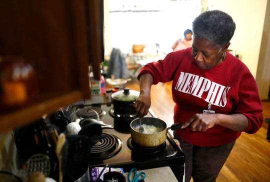 Dolores Kirk, an employee for SRVS, prepares dinner during her shift as house supervisor at an assisted living home on Thursday, Feb. 20, 2020. Across Tennessee, groups of direct support professionals are joining together to advocate for raising the average minimum wage for their profession from $10 per hour to $15.