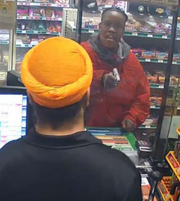 Marquel Johnson is shown on in a security camera image during gas station robbery in 2018