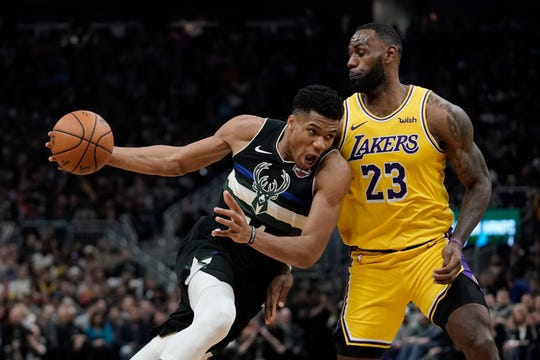 Giannis Antetokounmpo and LeBron James lead the Bucks and Lakers in Los Angeles.