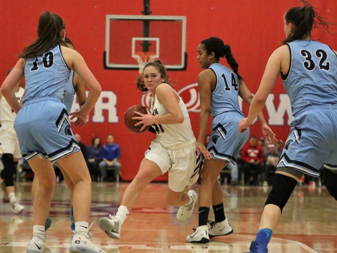 Germantown guard Natalie McNeal drives the lane against West Bend West during a WIAA sectional semifinal on March 5. McNeal earned first-team all-state honors for the third straight year.