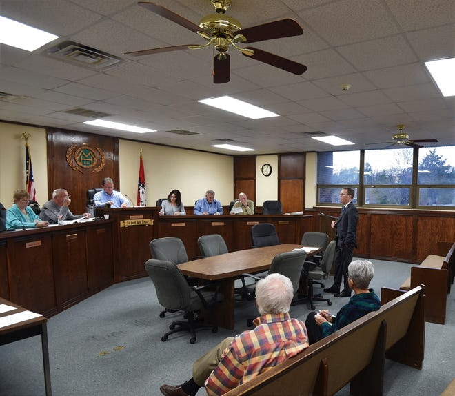 Ryan Bowman, a partner with the Friday, Eldredge & Clark law firm, stands Thursday evening to talks to the Mountain Home City Council about two sales tax proposals to fund park improvements and build a community/aquatic center.